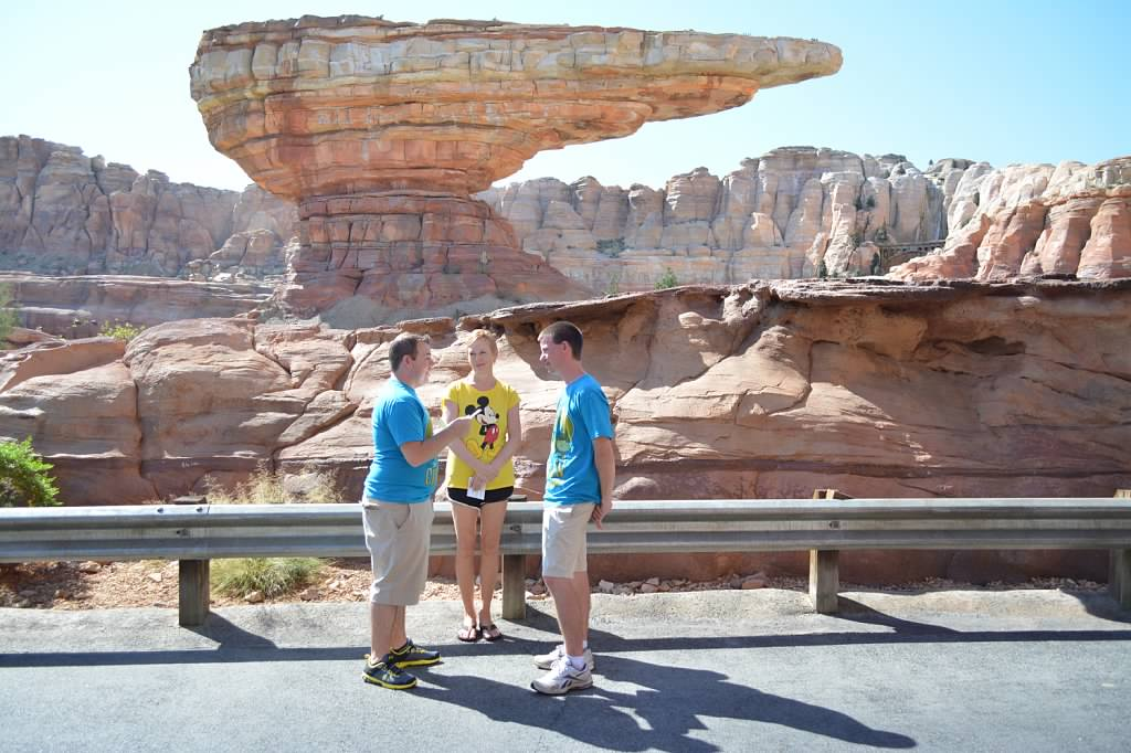 These grooms are Disneyphiles, so we dressed like tourists and snuck in a wedding at Carsland, at Disneyland