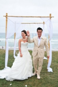 110600 Terri officiating Katy and Hectors wedding in La Jolla - hoopa or gazebo made out of fake bamboo