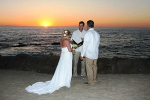 Mark Linzmeier officiating wedding at Pirates Cove by The Montage Hotel Laguna Beach at sunset